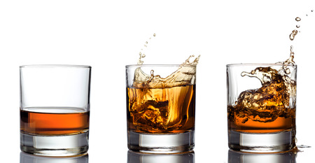 Glass of whiskey solated on white background photo