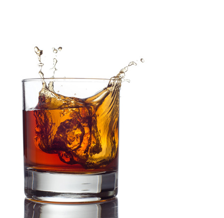 Glass of whiskey solated on white background 写真素材
