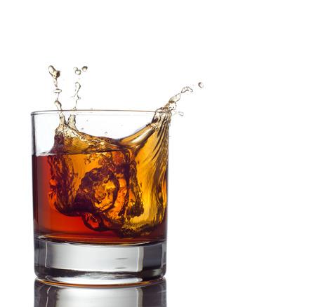 Glass of whiskey solated on white background Standard-Bild