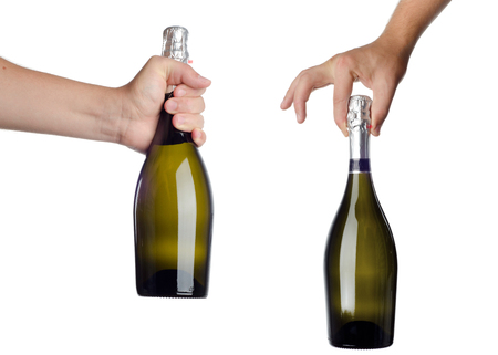 corked: Hand holding bottle of champagne isolated on white