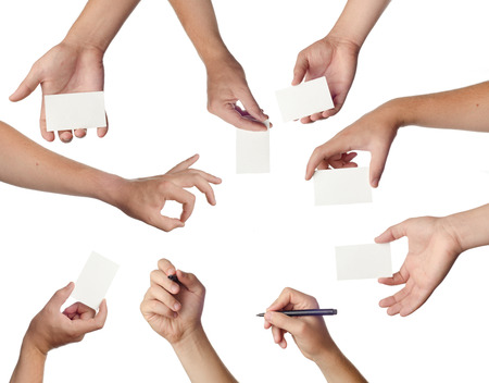 Set of hands holding empty business cards on white photo