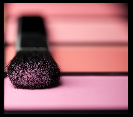 makeup brush and cosmetic powder close up Stock Photo
