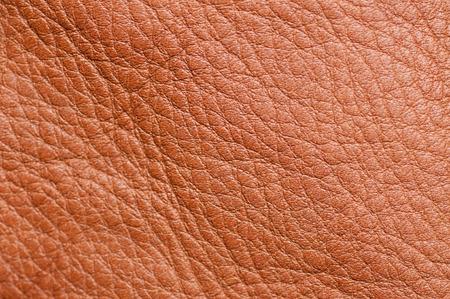 Cerca de la textura de cuero de Brown para arriba