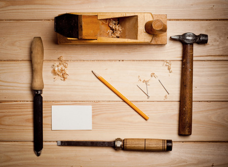 Desk of a carpenter with some tools photo