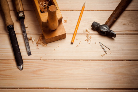 carpenter tools in pine wood table photo