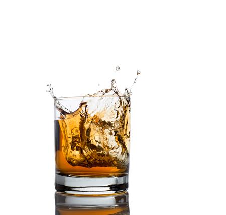 whisky splash isolated on a white background photo