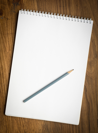 notebook with pencile on a wood background Stock Photo
