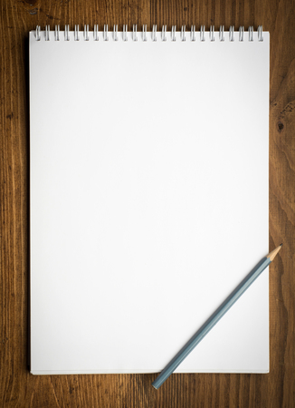 things to do: notebook with pencile on a wood background Stock Photo