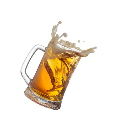 Splashing mug with beer isiolated on white background.