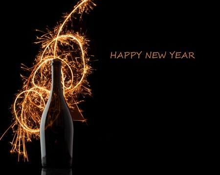 new day: New year 2015 background with champagne bottle and fire