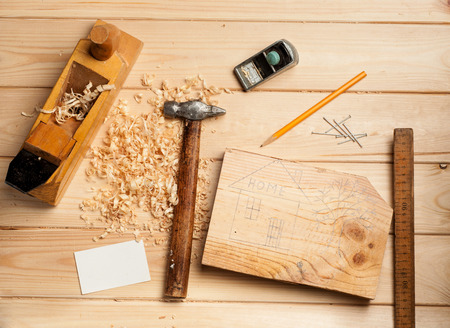 joinery: joinery tools on wood table background with business card and copy space