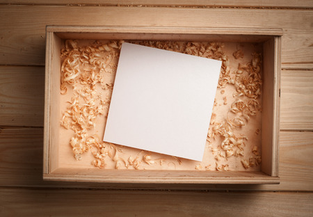Empty wooden box with blank paper and copy spase photo