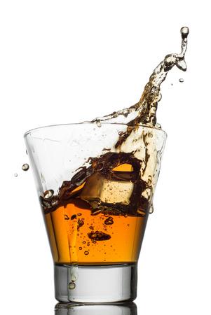 Isolated shots of whiskey with splash on white background photo