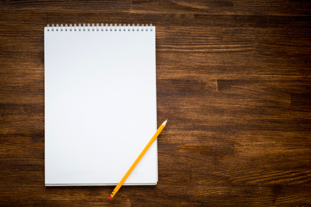 notebook with pencile on a wooden background Standard-Bild