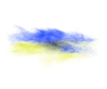 Blue and yellow powder explosion isolated on white Standard-Bild