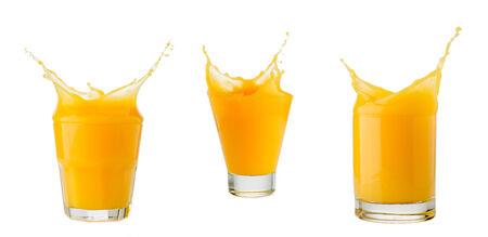 orange juice glass: orange juice splash in glass isolated on white