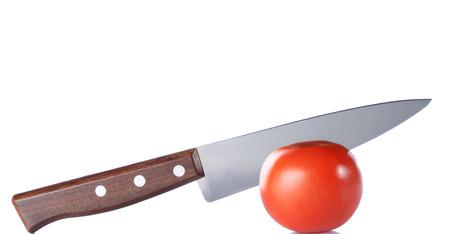Fresh tomato and knife isolated on white