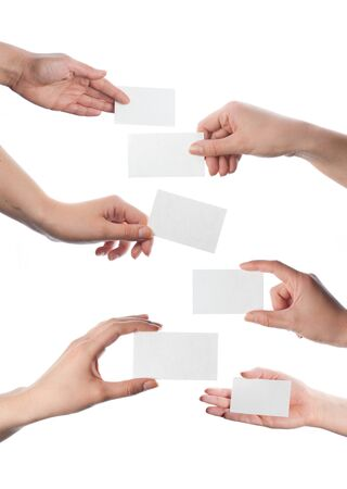 Set of hands holding empty business cards isolated on white photo