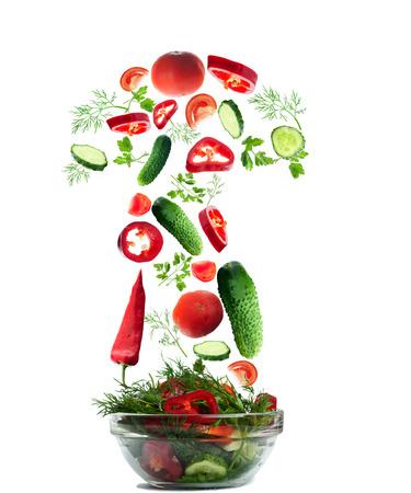 Fresh salad folling down on white background Zdjęcie Seryjne