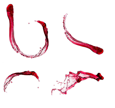Red wine splashes isolated on white background.