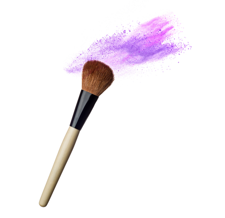 Makeup brushes and powder in motion isolated on white