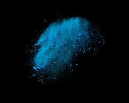 splatter: Explosión del color en polvo aislado en el fondo negro Foto de archivo