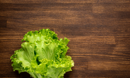 closeup isolate fresh lettuces  on wooden desk top view photo