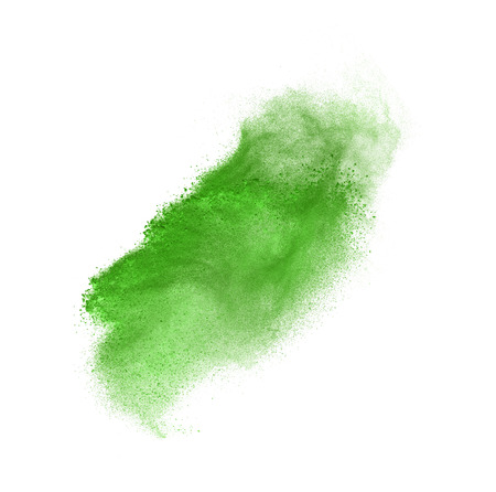 green powder: Green powder explosion isolated on white background