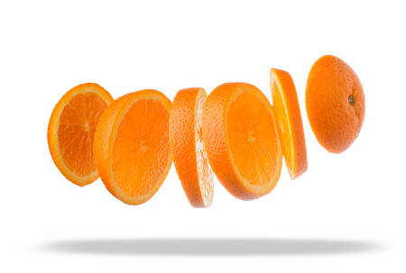 Falling slices of orange in air isolated on white background photo