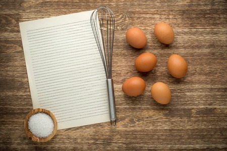 cardbox: eggs on a wooden background with copy space for your text