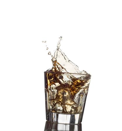 osolated: splash of whiskey with ice osolated on white. Stock Photo