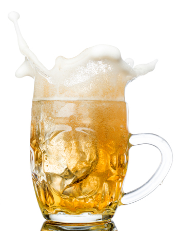 pouring beer: Beer splash in glasses isolated on white.