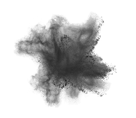 Freeze motion of black dust explosion isolated on white background. Stock Photo