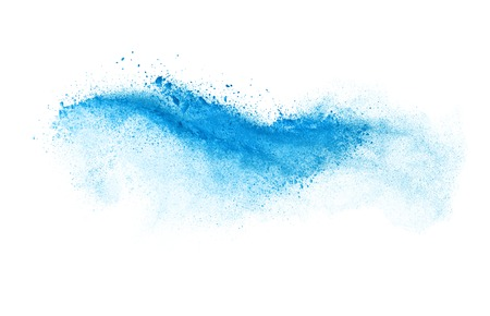 Freeze motion of blue dust explosion isolated on white background Foto de archivo