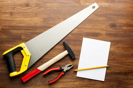 joinery: joinery tools on wood table background with note book and copy space. Stock Photo