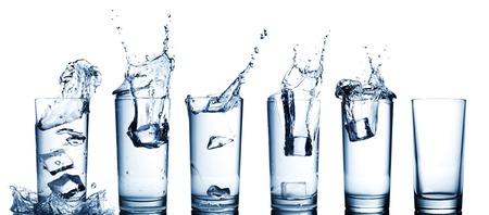water splash in glasses isolated on white. Archivio Fotografico