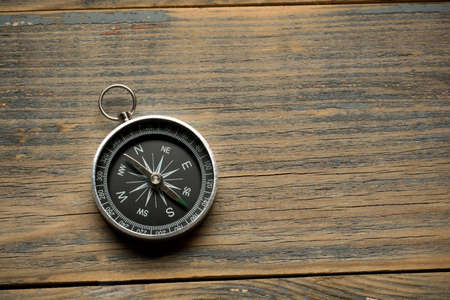 azimuth: compass on the brown wooden table background top view Stock Photo