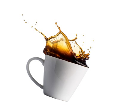 cup of splashing coffee isolated on white. Archivio Fotografico