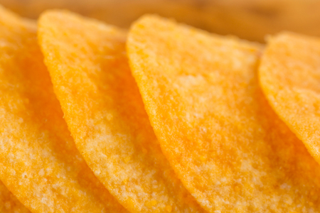 pomme: Detail of fried potato chips close up Stock Photo
