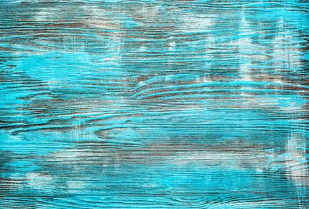 light blue wooden background close up.