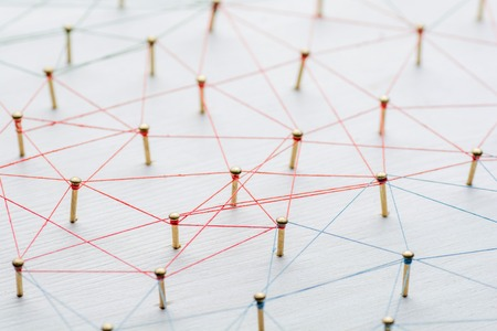 Background. Abstract concept of network, social media, internet, teamwork, communication. Nails linked together by threads. Stock Photo
