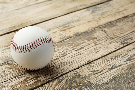 Baseball ball on old rustic wooden backstage
