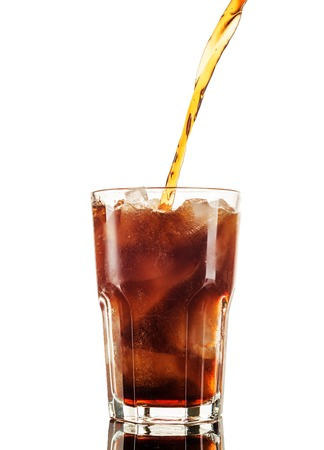 Cola in glass with straw and ice cubes isolated on white background Banco de Imagens