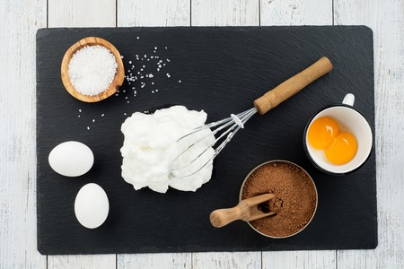 bakery concept,Ingredients for making chocolate cake on white wooden background,top view
