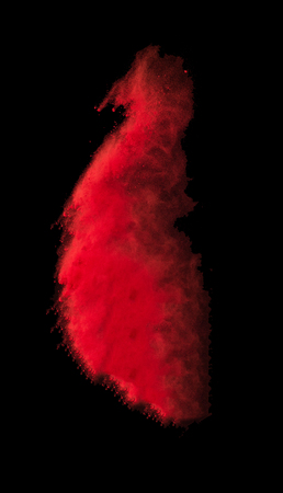 Explosion of colored powder on black background. Stock Photo