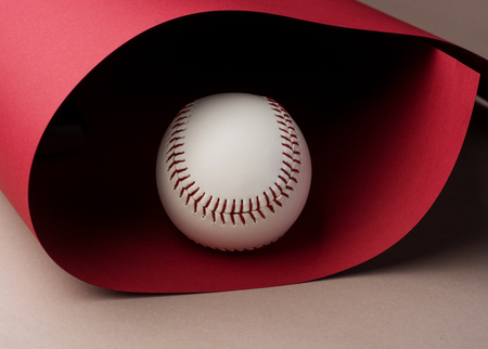 baseball on red background with copy space