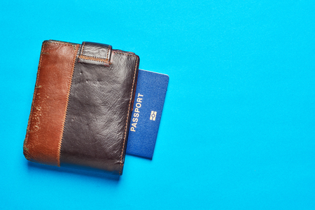 Passports and wallet with credit card on a blue paper background. Travel concept . Stock Photo