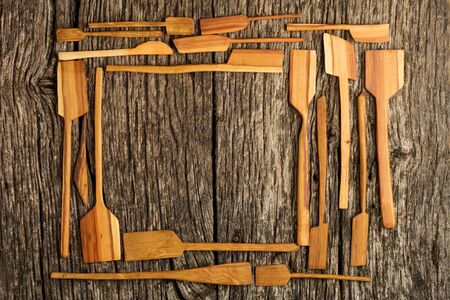 Rural kitchen utensils on vintage planked wood table from above - rustic background with free text space. Flat lay