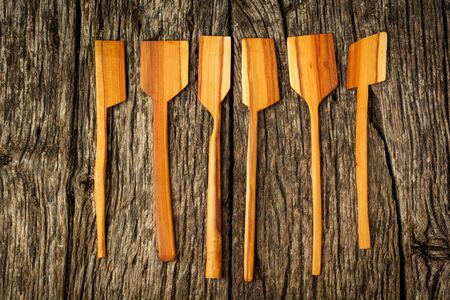 different kitchen wooden utensils close up on rustic wooden background. Banco de Imagens