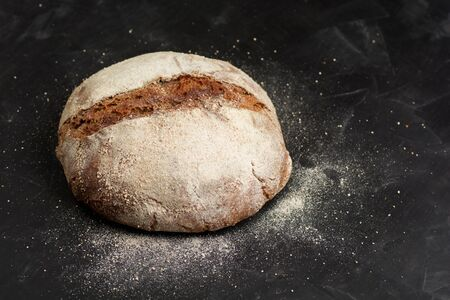 Traditional black rye-bread on dark table with copy space Zdjęcie Seryjne